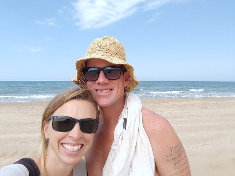 Couple on the beach in Oliva Spain.