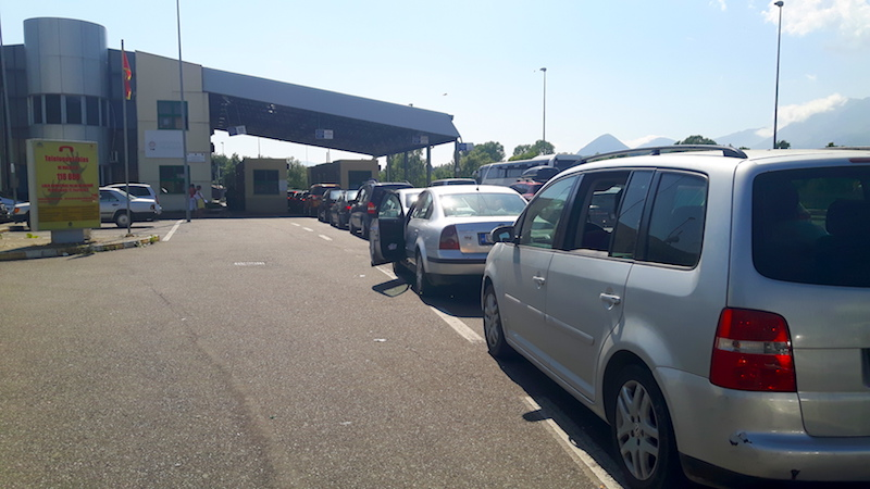 Line of cars at border between Albania and Montenegro.