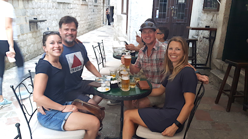 Friends having a drink in Kotor old town, Montenegro.