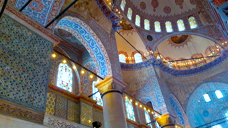Intricately tiled, carved and lit inside of Blue Mosque in Istanbul, Turkey.
