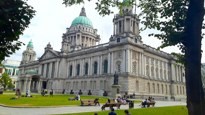 Ornate city hall with green dome roof in Belfast, Northern Ireland.