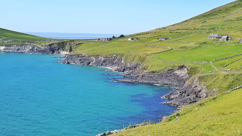 Impossibly blue water with green hills on the Dingle Peninsula, Ireland.
