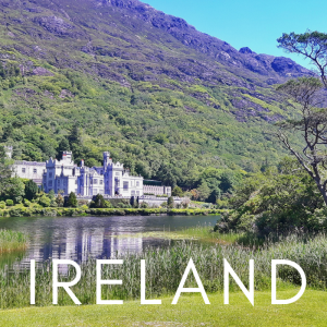 Kylemore Abbey on lake with mountains in Connemara, Ireland
