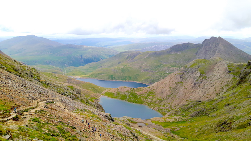 View across two lakes between mountains while climbing Mount Snowdon, Wales.