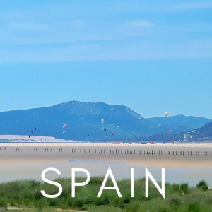 white sand, mountains, kitesurfing in Tarifa, Spain