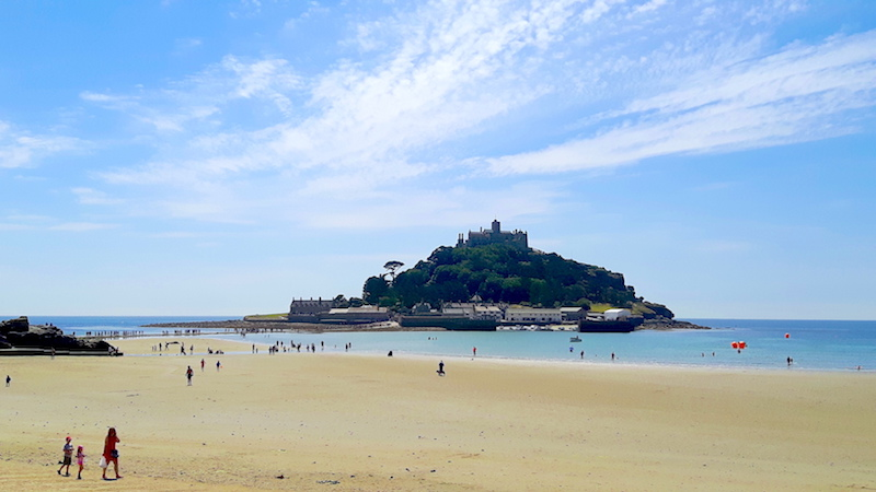 Across a golden beach to the island of St. Michael's Mount, Cornwall UK.