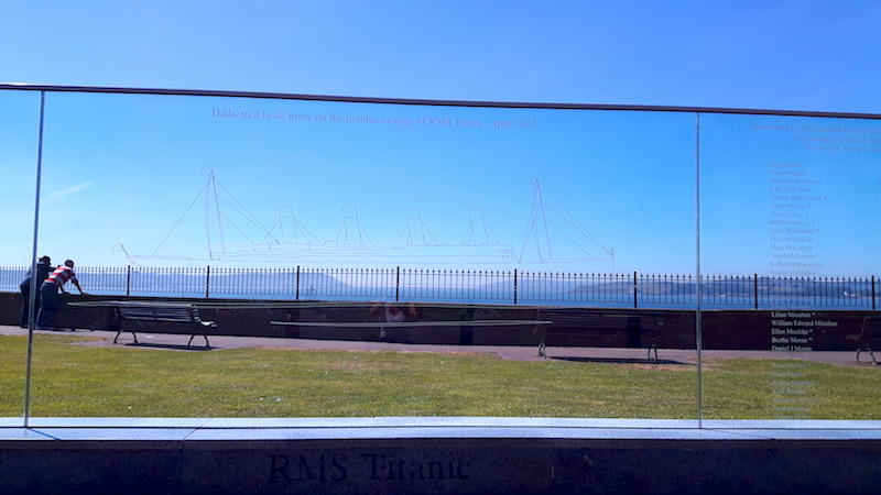Glass wall with outline of HMS Titanic etched into it and names of passengers in Cobh, Ireland.