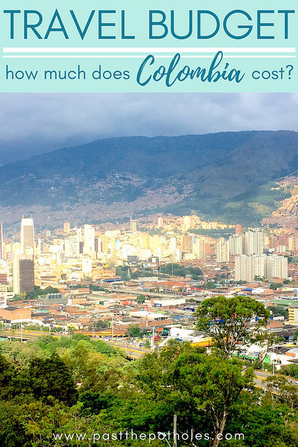 View of dense buildings in city of Medellin with text: Travel Budget, how much does Colombia cost?