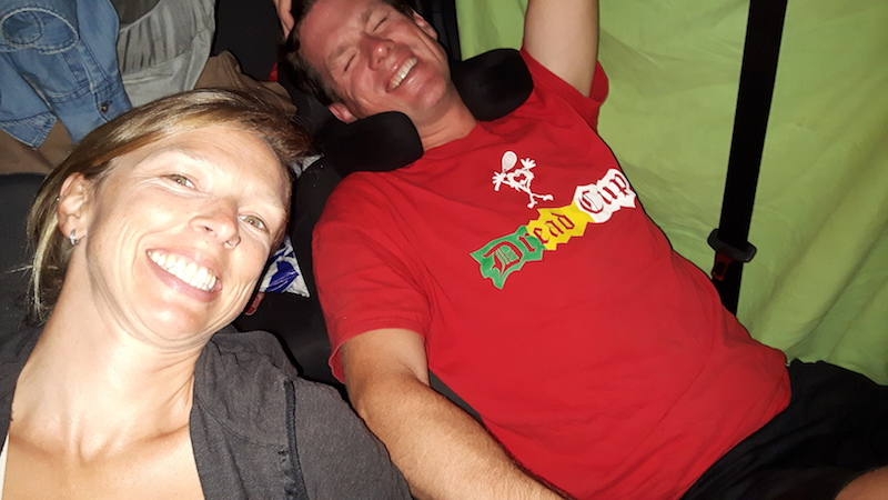 Man and woman preparing to sleep in a small car in Spain.