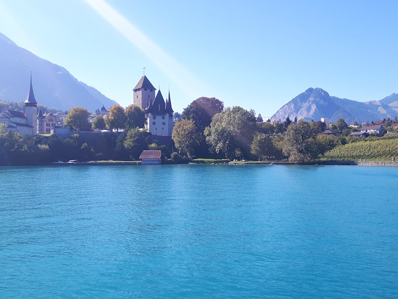 Church and castle in view of Spietz from Lake Thun ferry, Switzerland.