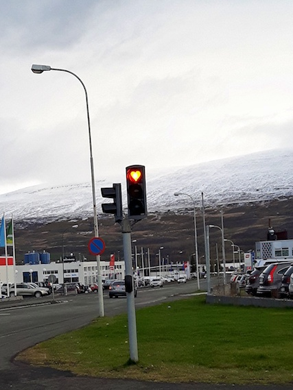 Traffic light in Akureyri, Iceland with a heart shaped red light.