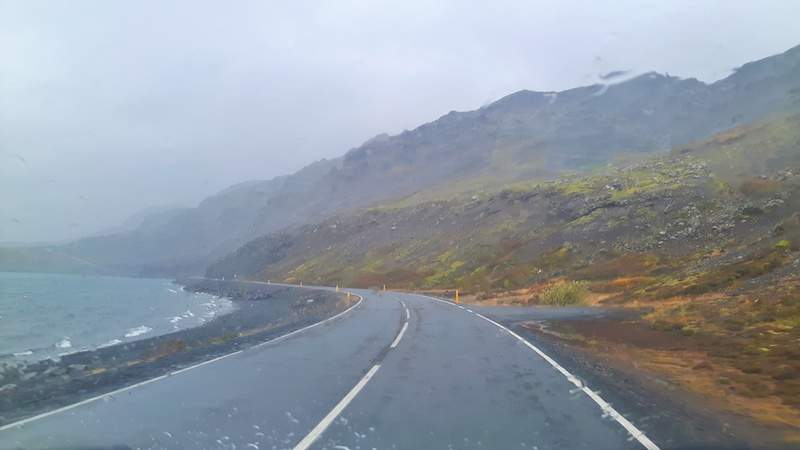 rain and wind while driving along a lake in Iceland