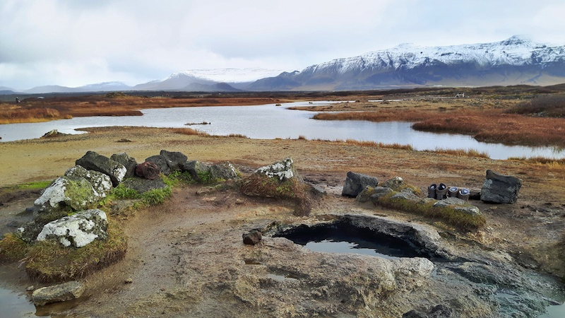 small natural hot spring in a field, Landbrotalaug Hot Pot, west Iceland