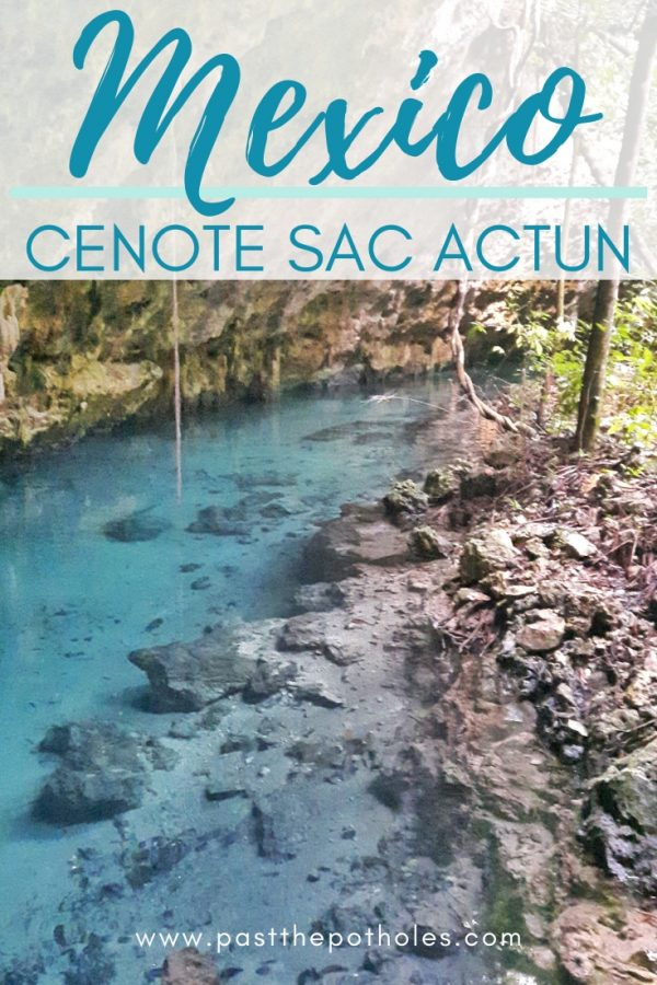 Turquoise water and rocks at cenote Sac Actun in Mexico with text overlay.