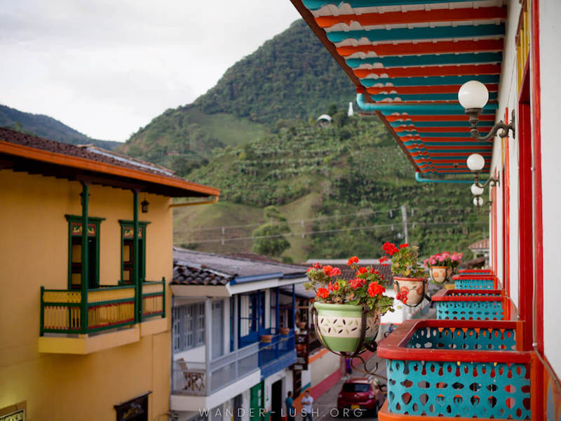 Colourful houses, flower baskets and mountains from a balcony in Jardín, Colombia.
