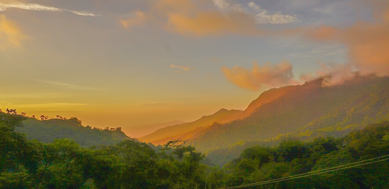 Orange haze over the hills looking out from Minca, Colombia.