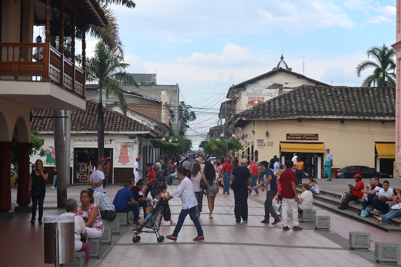 People walking in the street in the town of Buga, Colombia.