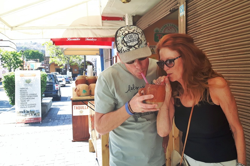 Man and woman sharing a drink in Tequila, Mexico.