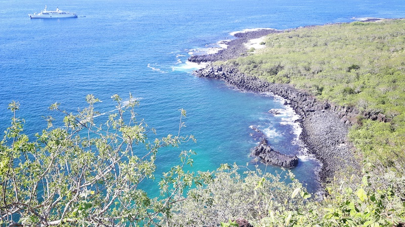 View from above of the turquoise Darwin's Cove from Cerro Tijeretas, San Cristobal, Galapagos.