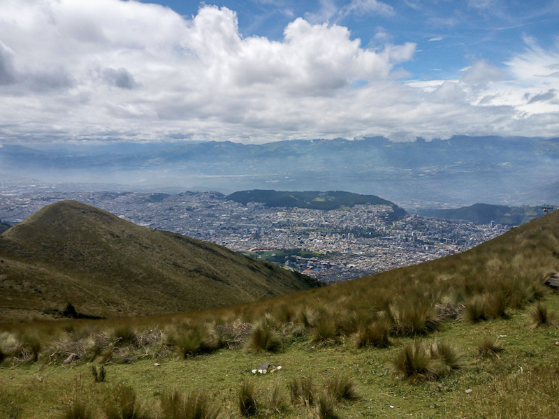Rolling hills and mountains from the top of Pichincha Volcano in Quito Ecuador.