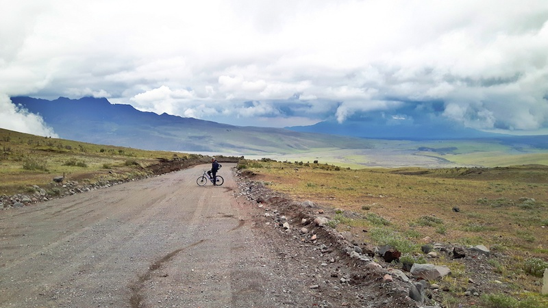 Man biking down from after Cotopaxi hike, Ecuador.
