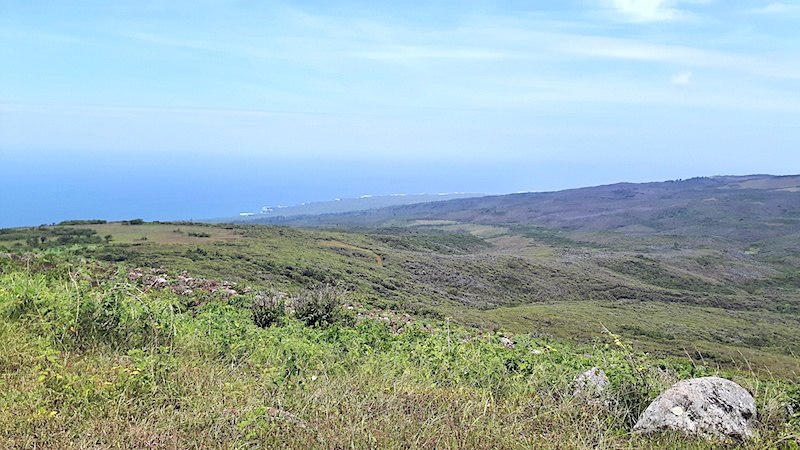 View across green landscapes to Pacific Ocean from El Junco, San Cristobal Galapagos.