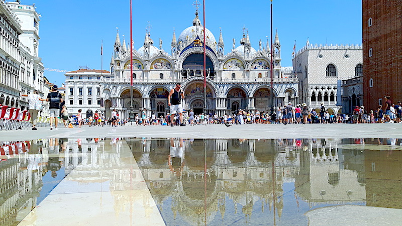 St Mark's Basilica reflected in a puddle in Venice Italy.