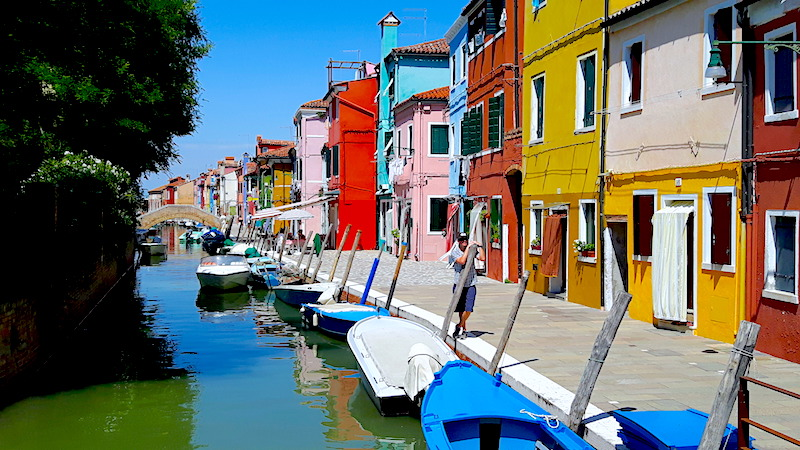 Walking along canal on day trip to Burano, Venice Italy.