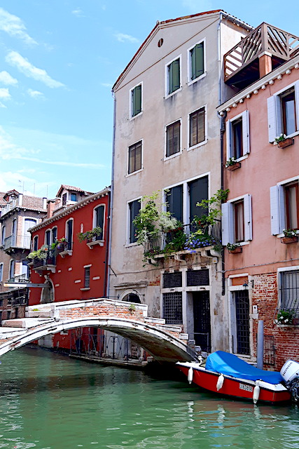 Small bridge over quiet Venice canal.
